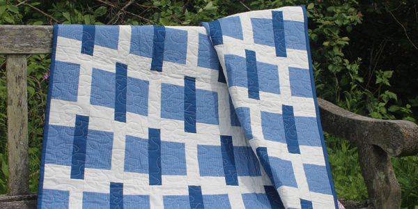 Studio R Quilts Sticks and Stones quilt on a park bench. Skill Builder - Quilt patterns to help you build quilting confidenc.